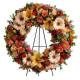 Corona funebre dai toni rosa e arancio