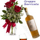 Bouquet di tre Rose rosse con Bottiglia di Grappa Barricata